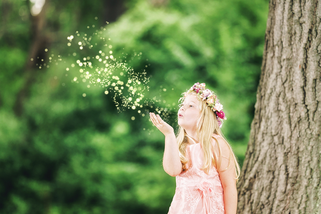 Fairy Session with Child Blowing Glitter