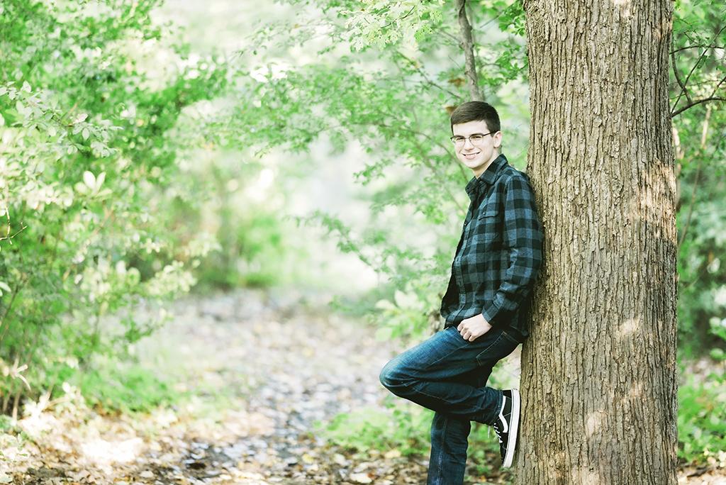 Michigan Senior Portraits - High School Senior Guy Leaning Against a Tree