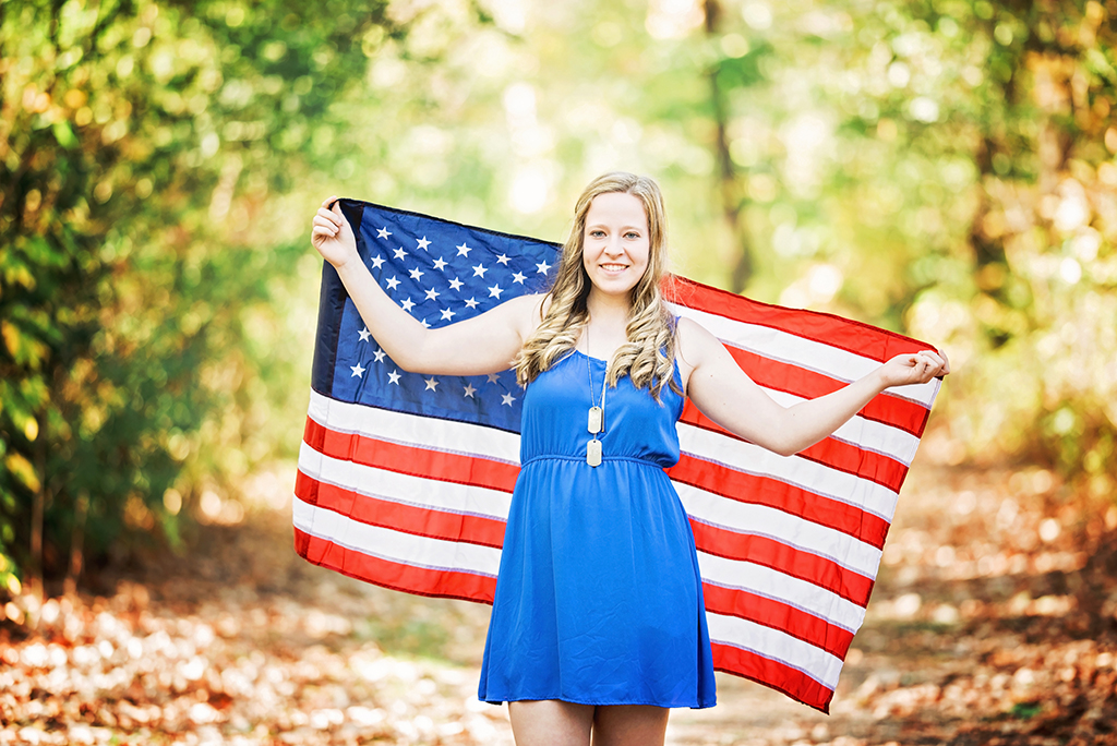 Michigan Senior Portraits - High School Senior with American Flag Behind Her