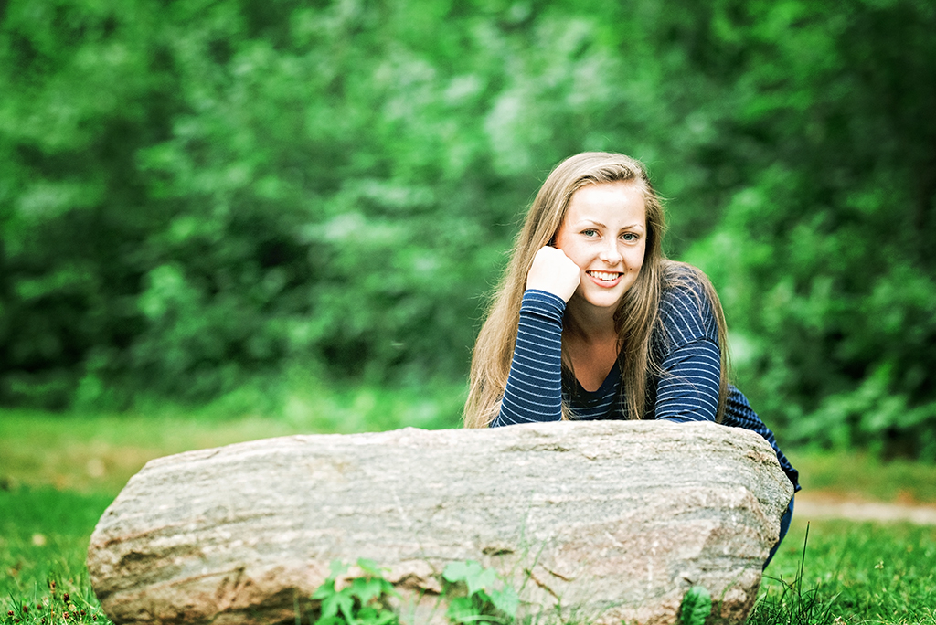 Michigan Senior Portraits - Senior Girl Leaning Against a Boulder